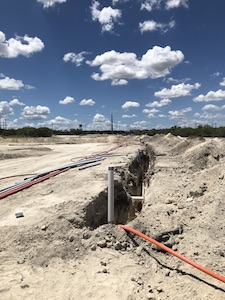 A typical onsite utility trench for gas and electric line installation was located within the developer's footprint.
